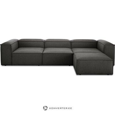 Tamsiai pilka kampinė sofa (skrydžio metu)