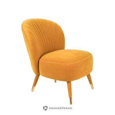 Oranžinis aksominis fotelis gerai apsirengęs (zuiveris)