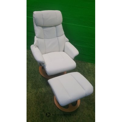 White full leather armchair in a row
