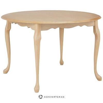 Beige pyöreä ruokapöytä