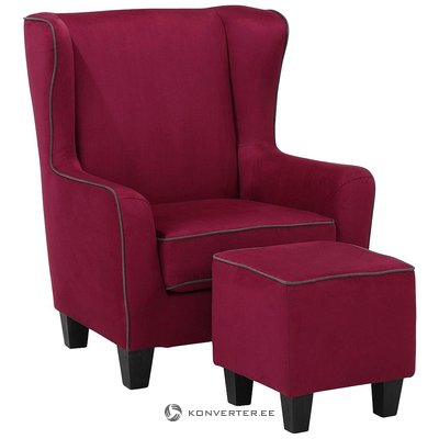 A red velvety armchair stinks