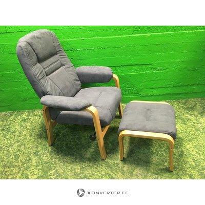 A gray wicker armchair in a row