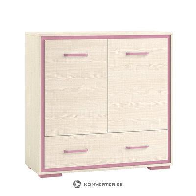 Bēša-rozā krāsas kumode ar rotaļīgu dizainu