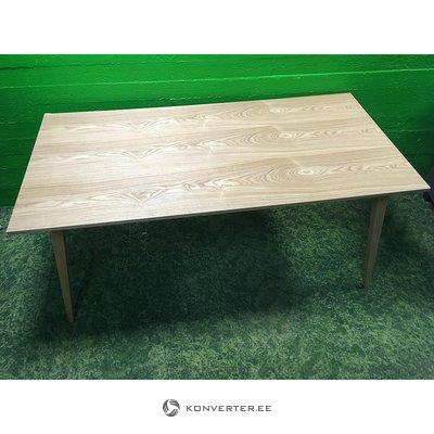 Light brown veneered dining table