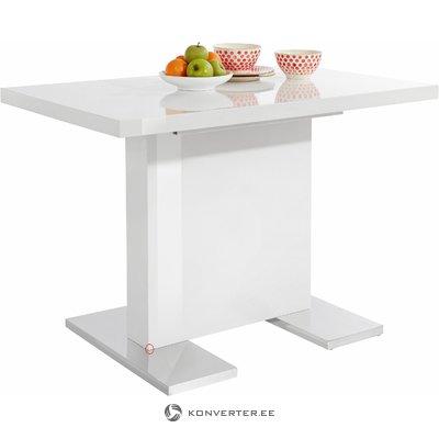 Pieni valkoinen kiiltävä ruokapöytä