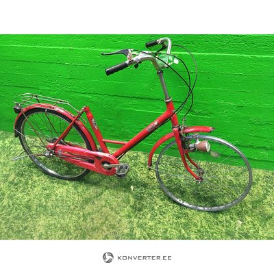 Red bicycle to be repaired with a luggage carrier