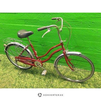 Punane retro jalgratas pakiraamiga