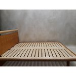 Light brown wooden bed
