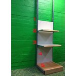 A narrower metal shelf with a smaller shelf
