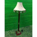 Red floor lamp with beige dome