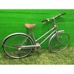 A silver bicycle to be refurbished
