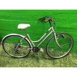 Defective light gray bike with gear