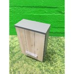 Small gray cabinet with light brown door