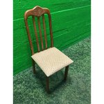 Brown wooden chair with a soft seat